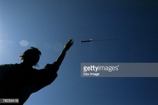 Samurai warrior throws a sword in the air : Stock Photo