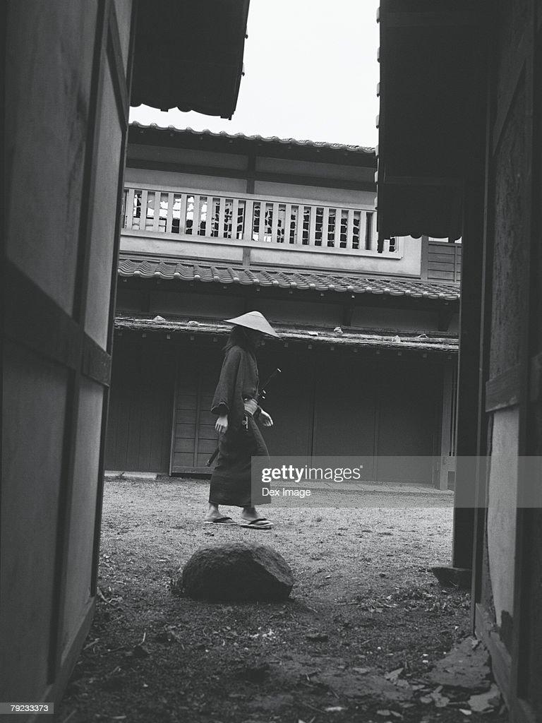 Samurai warrior walking in an estate : Stock Photo