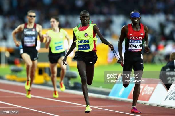 Samwel Mushai Kimani of Kenya crosses the line to win the Mens 1500m T11 final during day eight of the IPC World ParaAthletics Championships 2017 at...