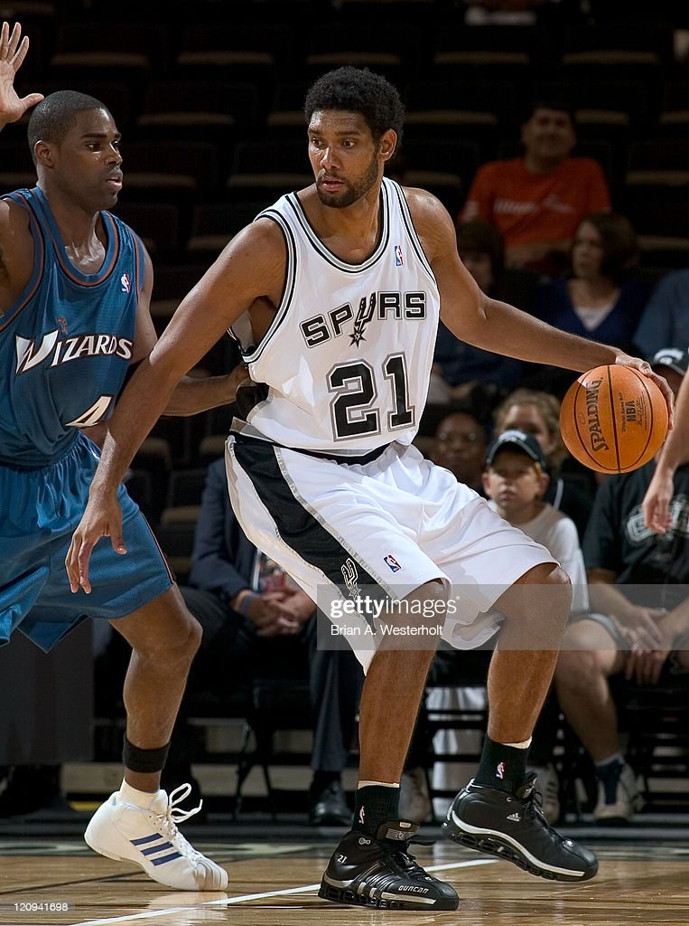 San Antonio center <a gi-track='captionPersonalityLinkClicked' href=/galleries/search?phrase=Tim+Duncan&family=editorial&specificpeople=201467 ng-click='$event.stopPropagation()'>Tim Duncan</a> (#21) backs down Washington Wizards forward <a gi-track='captionPersonalityLinkClicked' href=/galleries/search?phrase=Antawn+Jamison&family=editorial&specificpeople=201670 ng-click='$event.stopPropagation()'>Antawn Jamison</a> (#4) during first quarter action at the LJVM Coliseum in Winston-Salem, NC, October 13, 2005.