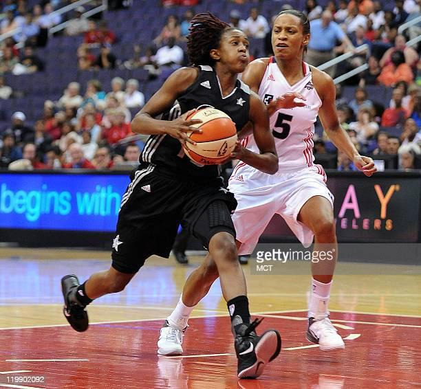 San Antonio Silver Stars guard Danielle Robinson drives the lane for a score against Washington Mystics guard Jasmine Thomas during the fourth...