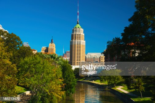 San Antonio skyline, riverwalk, and trees