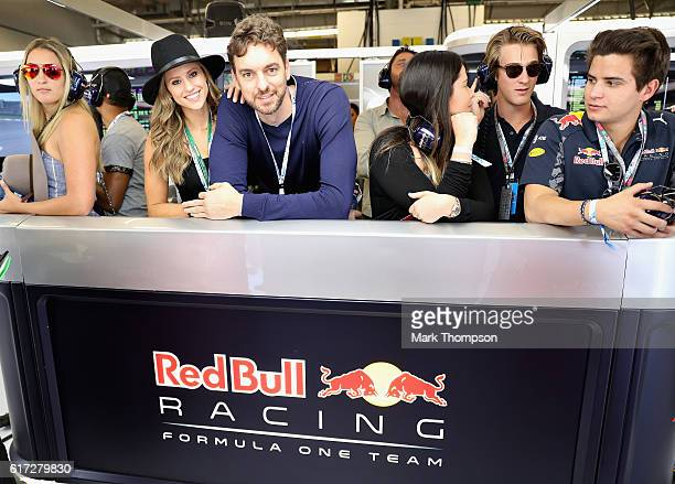 San Antonio Spurs basketball player Pau Gasol watches the action in the Red Bull Racing garage during qualifying for the United States Formula One...