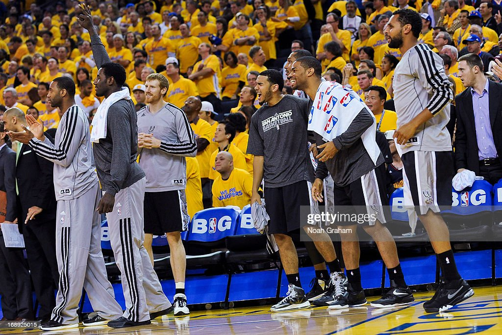 San Antonio Spurs bench players cheer on teammate Tony Parker #9 after he made a three-pointer late in the fourth quarter against the Golden State Warriors in Game Six of the Western Conference Semifinals during the 2013 NBA Playoffs on May 16, 2013 at Oracle Arena in Oakland, California.