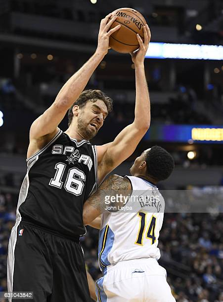 San Antonio Spurs center Pau Gasol pulls down a rebound from Denver Nuggets guard Gary Harris during the first quarter January 5 2016 at Pepsi Center