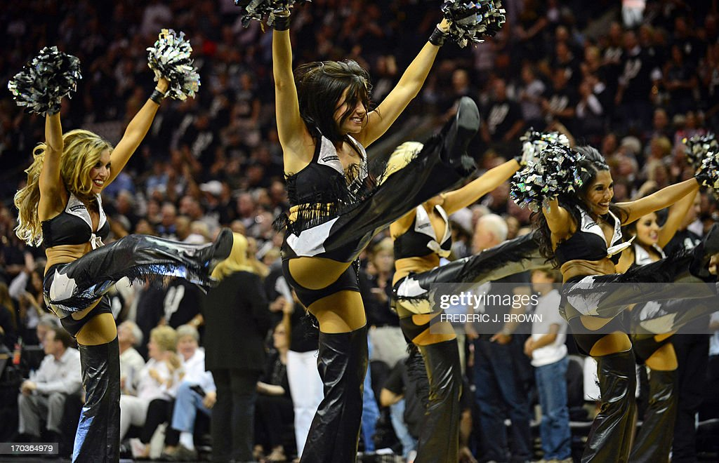 San Antonio Spurs cheerleaders entertain fans between the action against the Miami Heat during game 3 of the NBA finals on June 11, 2013 in San Antonio, Texas. The San Antonio Spurs defeated the Miami Heat 113-77. AFP PHOTO/Frederic J. BROWN