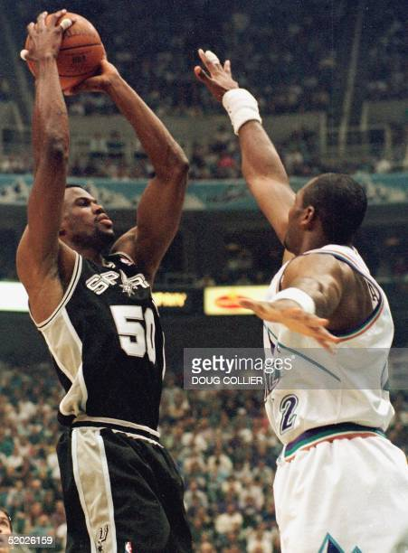 San Antonio Spurs David Robinson shoots over Utah Jazz Karl Malone during first period action of game two of their NBA Western Conference Semifinal...