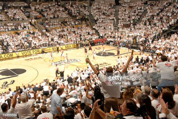 San Antonio Spurs fans celebrate after the Spurs scored against the Cleveland Cavaliers in Game One of the 2007 NBA Finals at the ATT Center on June...
