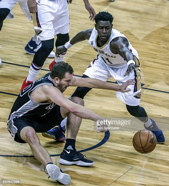 San Antonio Spurs forward David Lee has the ball stolen by New Orleans Pelicans guard Jrue Holiday during the game between the New Orleans Pelicans...