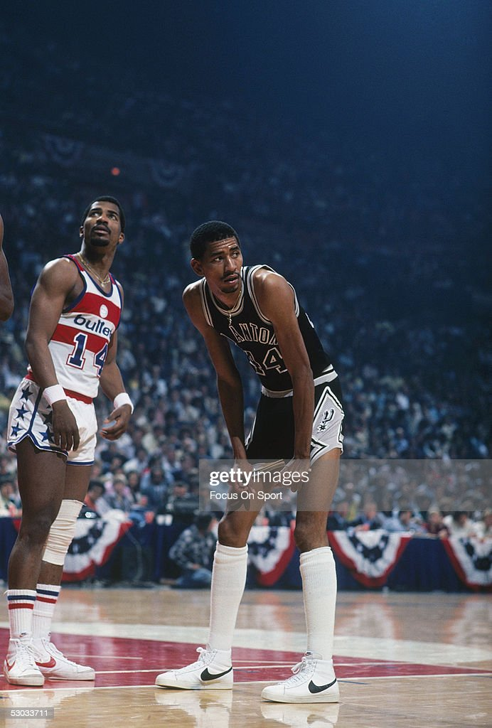 San Antonio Spurs' George Gervin pauses for a moment to rest during a game against the Washington Bullets at Capital Centre circa 1978 in Washington...