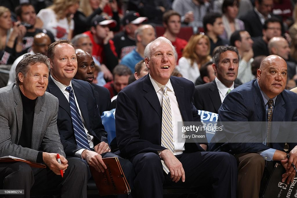 San Antonio Spurs head coach Gregg Popovich (3rd L) watches from the bench with assistant coaches Mike Budenholzer (2nd L) and Don Newman (R) during the game against the Chicago Bulls on February 17, 2011 at the United Center in Chicago, Illinois.