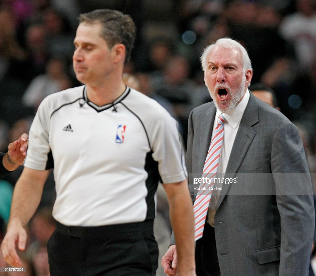 San Antonio Spurs head coach Gregg Popovich yells at David Guthrie after getting a technical during game against Toronto Raptors at AT&T Center on April 2, 2016 in San Antonio, Texas.