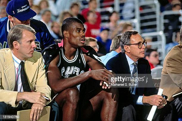 San Antonio Spurs head coach Larry Brown Assistant Coach Gregg Popovich and David Robinson sit on the bench circa 1989 at Madison Square Garden in...