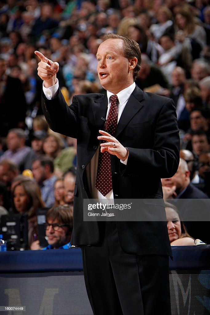 San Antonio Spurs interim coach Mike Budenholzer calls out a play against the Dallas Mavericks on January 25, 2013 at the American Airlines Center in Dallas, Texas.
