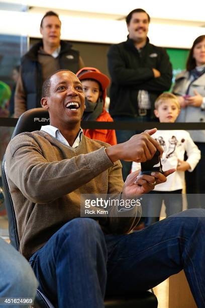 San Antonio Spurs' Legend Sean Elliott plays 'Forza Motorsports 5' for the new Xbox One with customers at the Microsoft retail store at The Shops at...