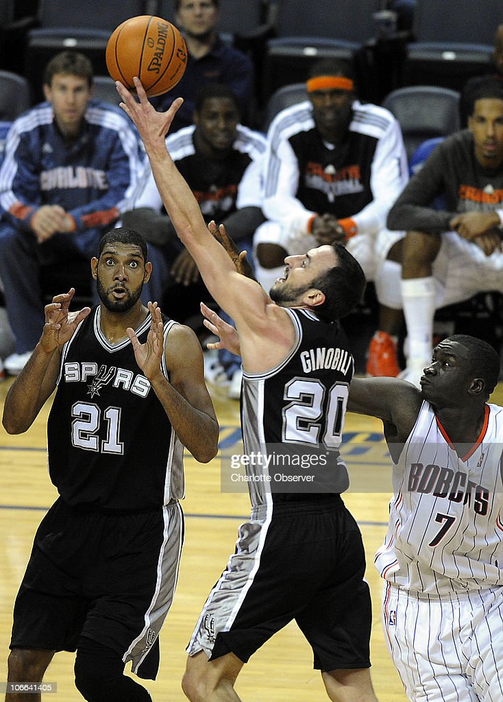 San Antonio Spurs' Manu Ginobili (20) drives down the lane past teammate <a gi-track='captionPersonalityLinkClicked' href=/galleries/search?phrase=Tim+Duncan&family=editorial&specificpeople=201467 ng-click='$event.stopPropagation()'>Tim Duncan</a> (21) and Charlotte Bobcats' DeSagana Diop (7) during the 2nd half at Time Warner Cable Arena in Charlotte, North Carolina, Monday, November 8, 2010. San Antonio won, 95-91.