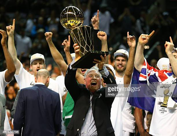 San Antonio Spurs owner Peter Holt celebrates with the Larry O'Brien trophy after defeating the Miami Heat to win the 2014 NBA Finals at the ATT...