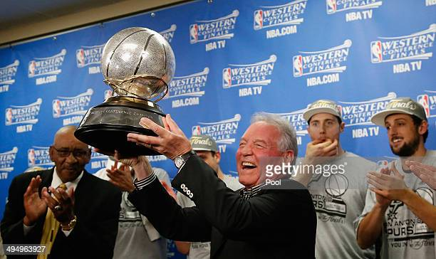 San Antonio Spurs owner Peter Holt celebrates with the Western Conference winner's trophy after the Spurs defeated the Oklahoma City Thunder 112107...