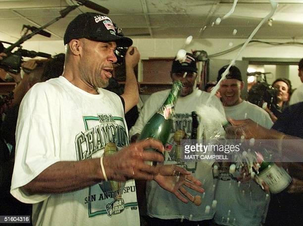 San Antonio Spurs player Mario Elie sprays champagne in the locker room after the Spurs defeated the New York Knicks during the NBA finals 25 June...