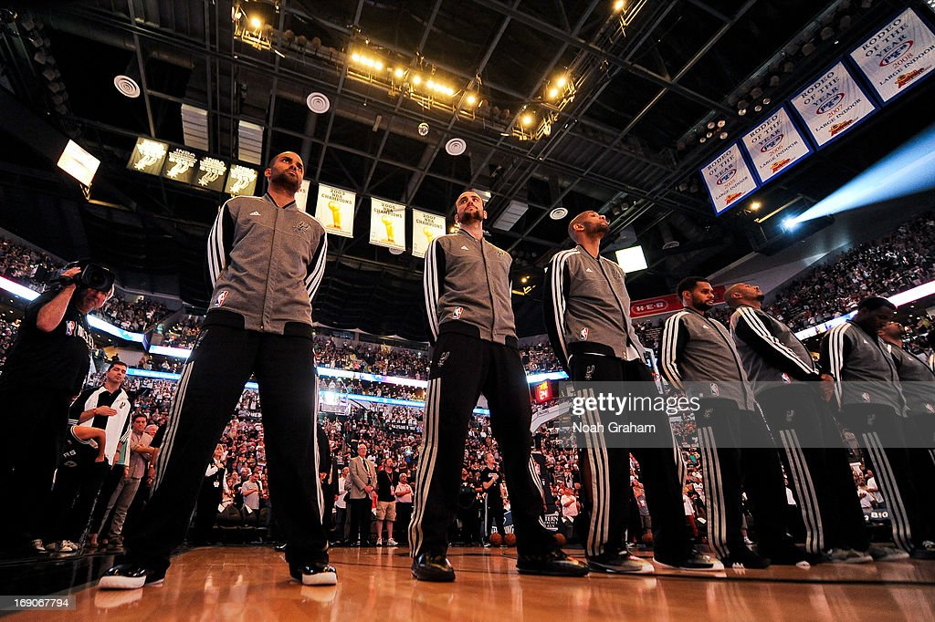 San Antonio Spurs players, from left, Tony Parker #9, Manu Ginobili #20 and Tim Duncan #21 listen to the National Anthem before playing against the Memphis Grizzlies in Game One of the Western Conference Finals during the 2013 NBA Playoffs on May 19, 2013 at the AT&T Center in San Antonio, Texas.