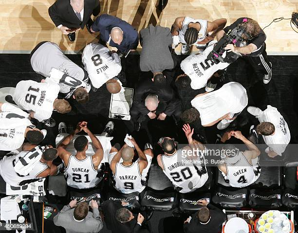 San Antonio Spurs players in the huddle during a time out with Head Coach Gregg Popovich during Game Five of the 2014 NBA Finals at ATT Center on...