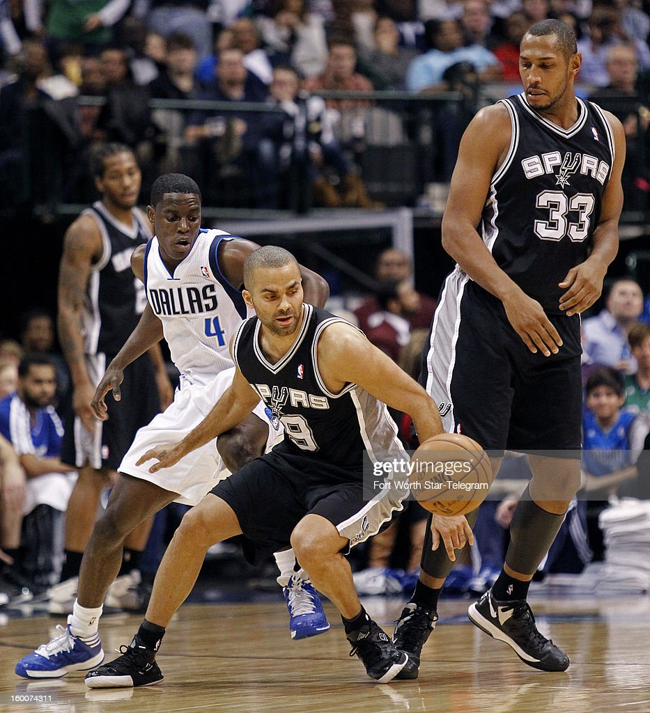 San Antonio Spurs point guard Tony Parker (9) scrambles away from Dallas Mavericks point guard Darren Collison (4) in the third quarter at the American Airlines Center in Dallas, Texas, Friday, January 25, 2013. The Spurs beat the Mavericks 113-107.