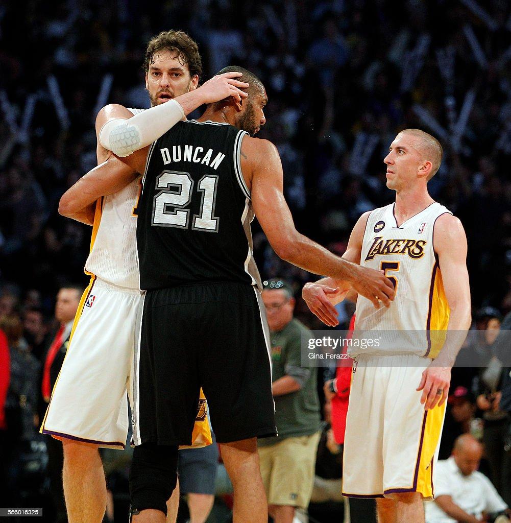 San Antonio Spurs power forward Tim Duncan 21 congratulates Los
