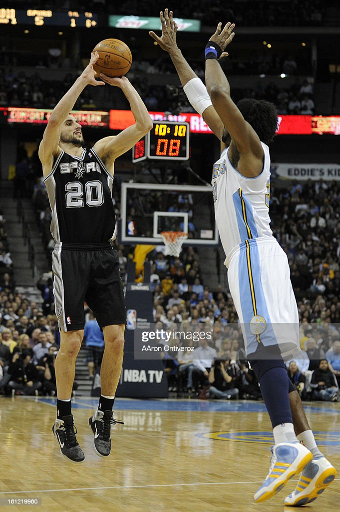 San Antonio Spurs shooting guard Manu Ginobili (20) takes a shot over Denver Nuggets center Nene (31) during the first quarter on Wednesday, March 23, 2011 at the Pepsi Center. AAron Ontiveroz, The Denver Post