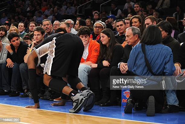 San Antonio Spurs' Stephen Jackson hurts ankle tripping over waitress in front of Michael Bloomberg courside at Madison Square Garden