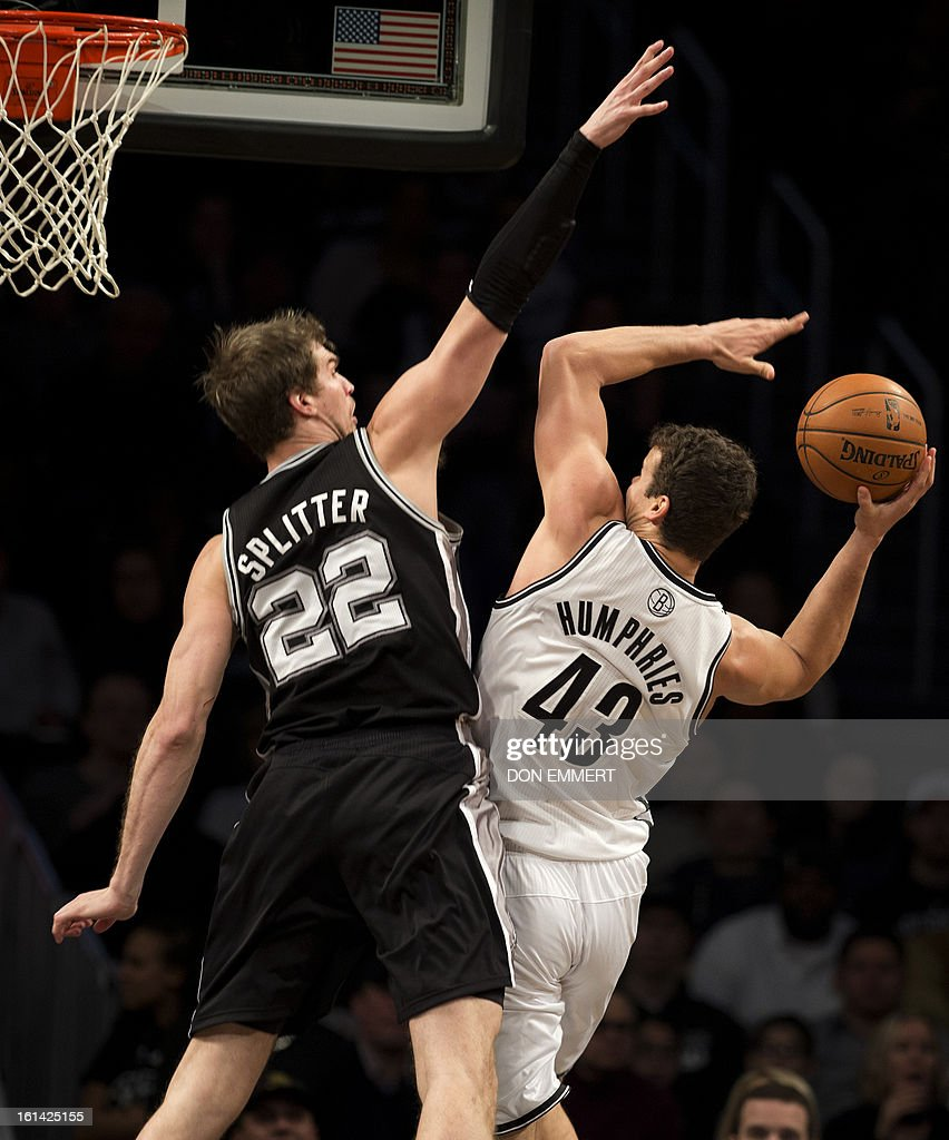 San Antonio Spurs Tiago Splitter (L) tries to block Brooklyn Nets Kris Humphries during their NBA game February 10, 2013 at the Barclay Center in New York.