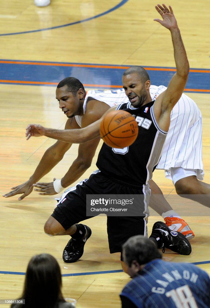 San Antonio Spurs' Tony Parker (9) and Charlotte Bobcats' Boris Diaw (32) collide while going after the ball during the 2nd half at Time Warner Cable Arena in Charlotte, North Carolina, Monday, November 8, 2010. San Antonio won, 95-91.