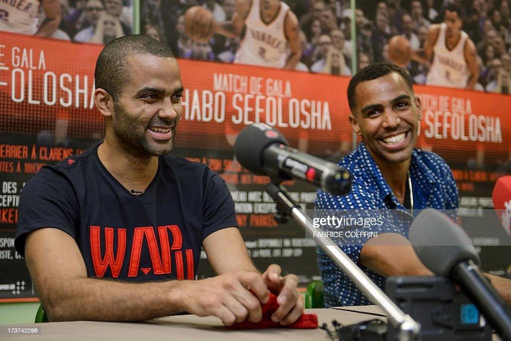 San Antonio Spurs' Tony Parker of France (L) reacts next to Oklaoma City Thunder's Thabo Sefolosha of Switzerland during a press conference ahead of a charity basketball match on July 17, 2013 in Clarens near Montreux, western Switzerland. AFP PHOTO / FABRICE COFFRINI
