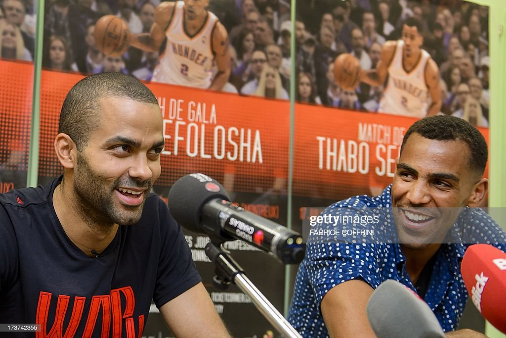 San Antonio Spurs' Tony Parker of France (L) reacts next to Oklaoma City Thunder's Thabo Sefolosha of Switzerland during a press conference ahead of a charity basketball match on July 17, 2013 in Clarens near Montreux, western Switzerland.