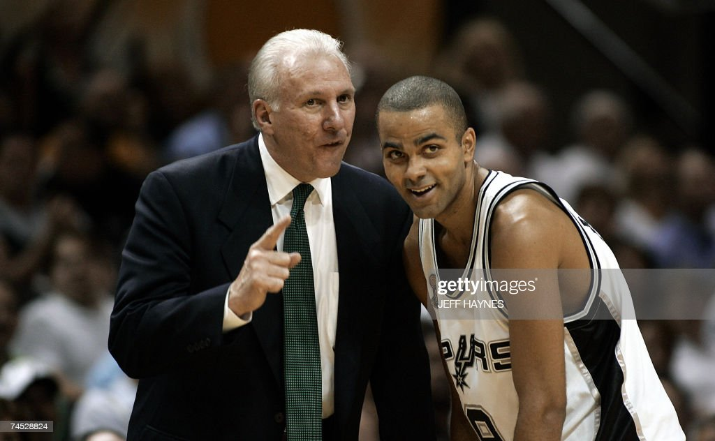 Head coach Gregg Popovich (L) of the San Antonio Spurs talks with Tony Parker (R) in the first half during Game Two of the NBA Finals against the the Cleveland Cavaliers 10 June 2007 at the AT&T Center in San Antonio, Texas. AFP PHOTO/Jeff HAYNES