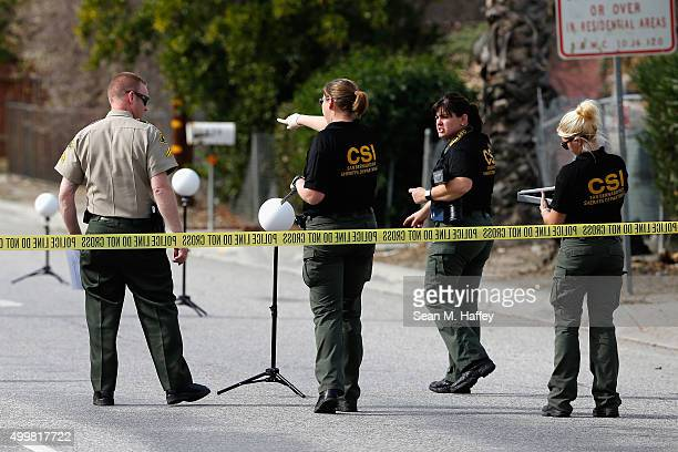 San Bernadino Sheriff's CSI investigate the crime scene where suspects of a mass shooting at the Inland Resource Center were killed on December 3...
