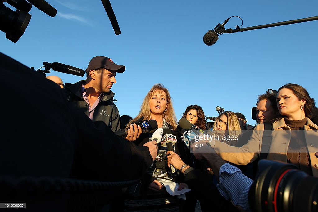 San Bernardino County Sheriffs Department Public Information Officer Cindy Bachman speaks to reporters at a roadblock on Highway 38 which leads to the Big Bear Lake, California as a standoff with the former Los Angeles police officer who is now-quadruple murder suspect Christopher Dorner continues, near San Bernardino, California February 12, 2013, some 46 miles (75 km) from the San Bernardino Mountains near Big Bear, California where Dorner, a former US cop, has barricaded himself in a cabin and exchanged gunfire with police who have the cabin surrounded. AFP PHOTO / David McNew