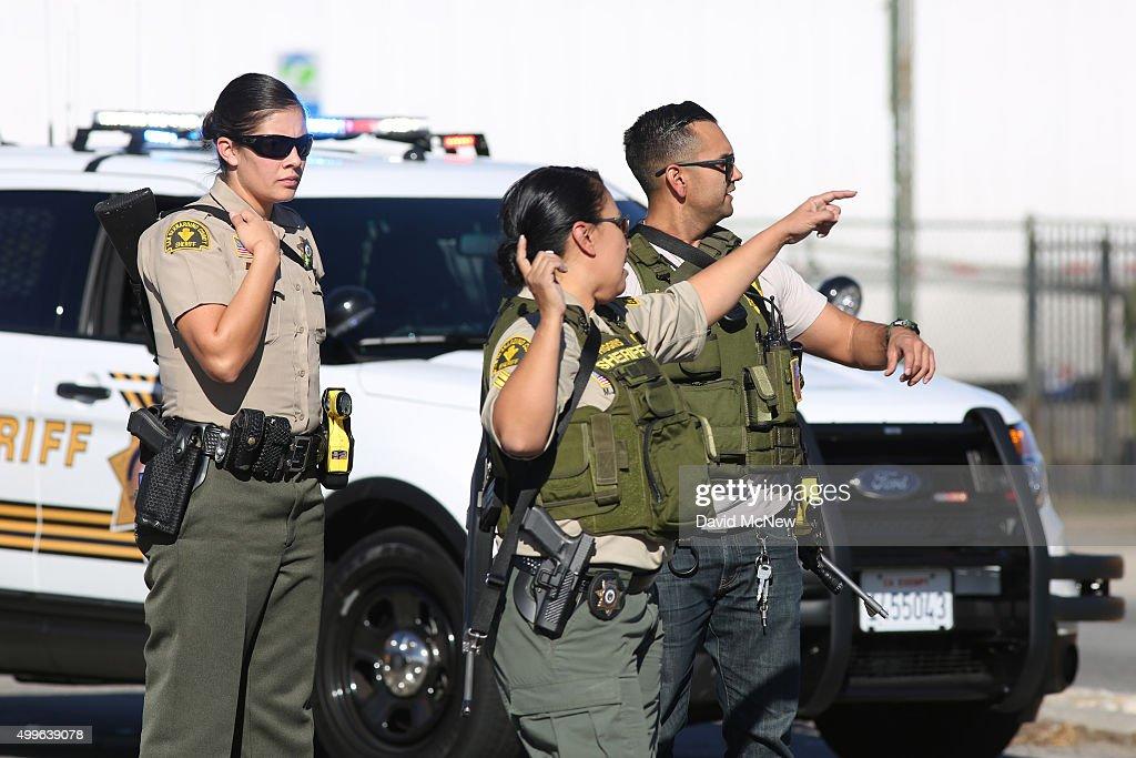 San Bernardino County Sheriffs deputies respond to a mass shooting at the Inland Regional Center December 2 2015 in San Bernardino California...