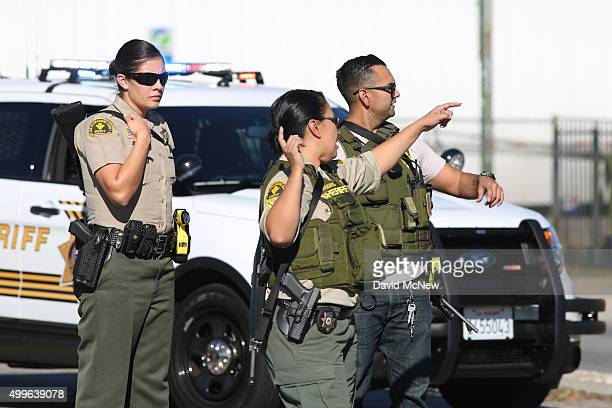 San Bernardino County Sheriffs deputies respond to a mass shooting at the Inland Regional Center December 2 2015 in San Bernardino California...