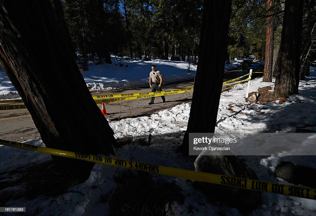 San Bernardino County Sheriff's deputy Alex Cundieff secures the scene where a P22 Walther Suppressor hand gun was found in the snow just off Glass Road near where former Los Angeles Police Department officer Christopher Dorner crashed a purple Nissan truck, before carjacking a second truck as he was fleeing from law enforcement on February 15, 2013 in Big Bear, California. The gun was spotted February 15, by a local citizen. Dorner barricaded himself in a cabin near Big Bear, California, and engaged law enforcement officers in shootout, shooting two police, killing one and wounding the other. Dorner, a former Los Angeles Police Department officer and Navy Reserve veteran, who's body was identified in the burned cabin, was wanted in connection with the deaths of an Irvine couple and a Riverside police officer.