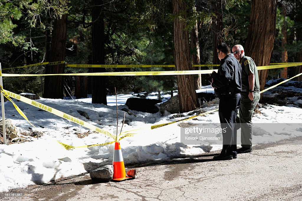 San Bernardino County Sheriff's homicide investigators arrive to retrieve a P22 Walther Suppressor hand gun found in the snow just off Glass Road presumably belonging to multiple murder suspect former Los Angeles Police Department officer Christopher Dorner after he crashed a purple Nissan truck, before carjacking a second truck as he was fleeing form law enforcement officer on February 15, 2013 in Big Bear, California. The gun was spotted February 15, by a local citizen. Dorner barricaded himself in a cabin near Big Bear, California, and engaged law enforcement officers in shootout, shooting two police, killing one and wounding the other. Dorner, a former Los Angeles Police Department officer and Navy Reserve veteran, who's body was identified in the burned cabin, was wanted in connection with the deaths of an Irvine couple and a Riverside police officer.