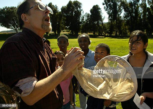 San Bernardino March 30 2005 – – – Science teacher Dave Goodward reacts as a painted lady butterfly escapes the net during a science project...