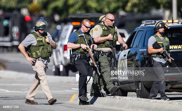San Bernardino police offices in SWAT gear secure the scene where a mass shooting occurred at the Inland Regional Center on December 2 2105 in San...