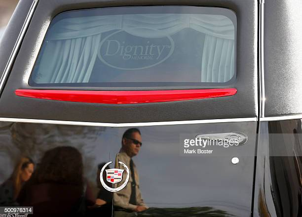 San Bernardino Sheriff Deputy is reflected in the hearse as mourners gather at St Catherine Of Alexandria in Riverside for the funeral of Damian...