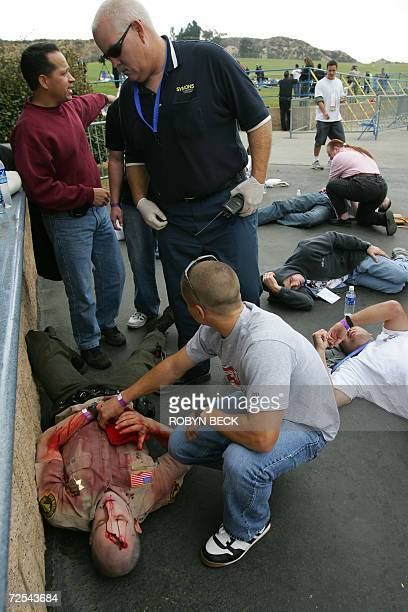A paramedic arrives to 'examine' an actor playing a sherrif's deputy injured in a terrorist explosion during 'Golden Guardian' California's annual...