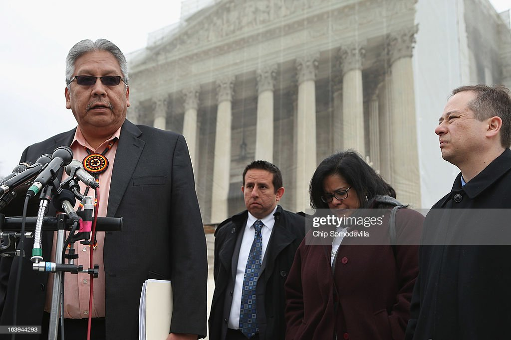 San Carlos Apache Tribal Chairman Terry Rambler (L) talks with reporters outside the U.S. Supreme Court after attending oral arguements in Arizona v. Inter Tribal Council et al. March 18, 2013 in Washington, DC. The court is hearing arguments about the constitutionality of an Arizona law requiring applicants to prove their citizenship before registering to vote under the federal National Voter Registration Act.