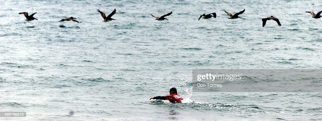 San Clemente––On an overcast morning pro surfers battled high tide small waves and the passing pelicans in the Association of Surfing Professionals...