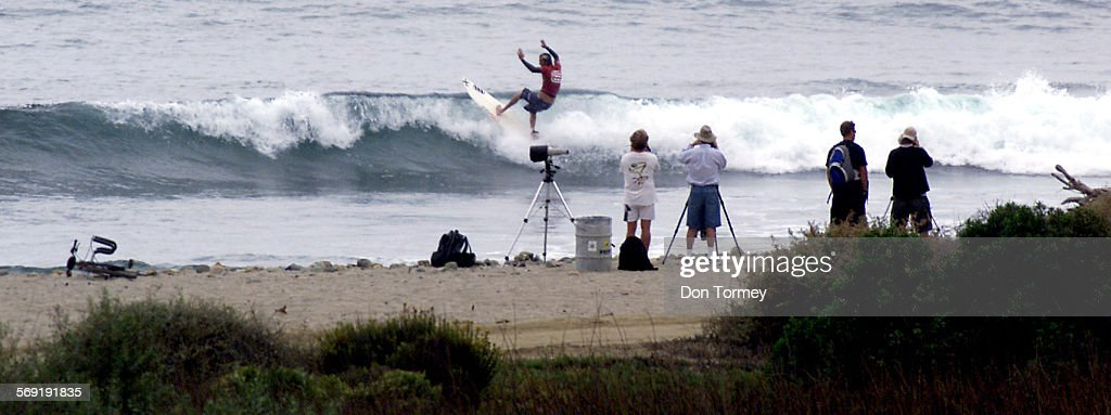 San Clemente––Photographers and spectators watch as some of the top pro surfers in the world try to make the most of the small wave conditions today...