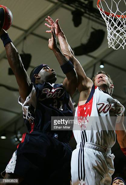 San Diego Charger/east coast player LaDainian Tomlinson shoots the ball against actor/west coast player James Denton during the McDonald's NBA...