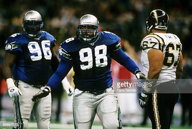 San Diego Chargers center Roman Fortin and Seattle Seahawks defensive tackle Cortez Kennedy watch as Seattle Seahawks defensive tackle Sam Adams 98...