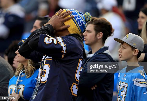 San Diego Chargers fan looks on during the second half of a game against the Kansas City Chiefs at Qualcomm Stadium on January 1 2017 in San Diego...